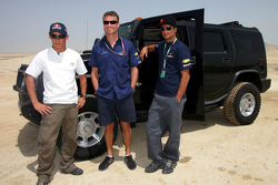 Christian Klien,David Coulthard and Vitantonio Liuzzi try a Hummer in the Bahrain desert