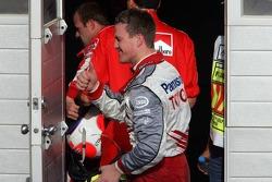 Ralf Schumacher congratulates teammate Jarno Trulli after the race