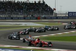 First corner: Michael Schumacher and Jarno Trulli battle