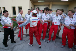 Jarno Trulli celebrates with Toyota team members