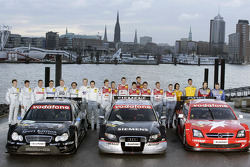 Family picture: the drivers of the 2005 DTM with their cars