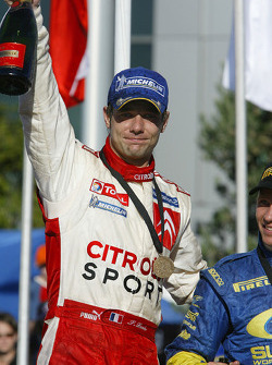 Podium: rally winner Sébastien Loeb celebrates