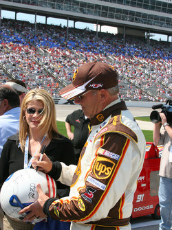 Dale Jarrett signs a helmet for a fan