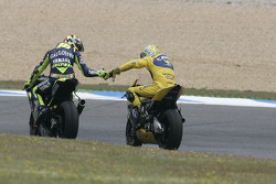 Race winner Alex Barros celebrates with Valentino Rossi