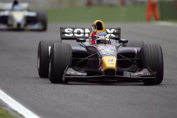 Race winner Heikki Kovalainen celebrates