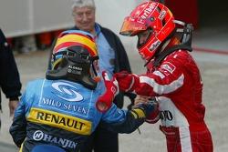 Fernando Alonso and Michael Schumacher congratulate each other