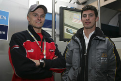 Heikki Kovalainen and Jose Maria Lopez in the Renault F1 garage area