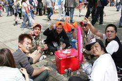 Fans enjoy a snack