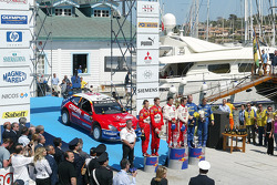 Podium: winners Sébastien Loeb and Daniel Elena, with Petter Solberg and Phil Mills, and Marcus Gronholm and Timo Rautiainen