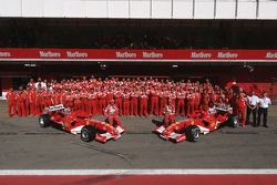 Ferrari photoshoot: Michael Schumacher and Rubens Barrichello pose with Ferrari team members