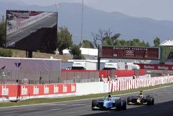 Nelson A. Piquet leads Scott Speed