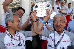Tsutomu Tomita and Dr Akihiko Saito celebrate podium finish