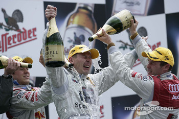Podium: champagne for Mika Hakkinen, Mattias Ekstrm and Tom Kristensen