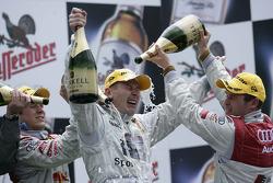 Podium: champagne for Mika Hakkinen, Mattias Ekström and Tom Kristensen