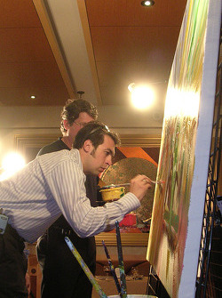 6th Annual Sam Schmidt Paralysis Foundation fundrasing gala: Sam Hornish Jr. signs Bill Patterson's painting