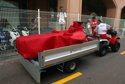 Toyota team members bring a new chassis after the crash of Ralf Schumacher