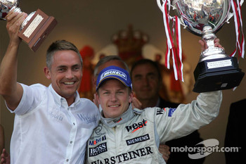 Podium: race winner Kimi Raikkonen celebrates with Martin Whitmarsh