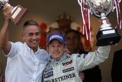 Podium: race winner Kimi Raikkonen celebrates with Martin Whitmarsh