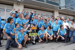 Race winner Fernando Alonso celebrates with his team