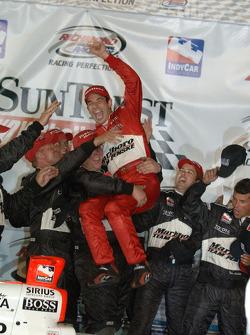 Victory lane: race winner Helio Castroneves celebrates