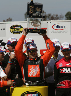 Victory lane: race winner Tony Stewart celebrates