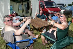 Fans enjoy a beer