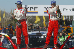 Podium: race winners Sébastien Loeb and Daniel Elena celebrate