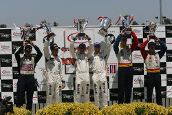 GT2 podium: class winnners Timo Bernhard and Romain Dumas, with Michael Petersen, Patrick Long and Jorg Bergmeister, and Wolf Henzler and Mike Rockenfeller