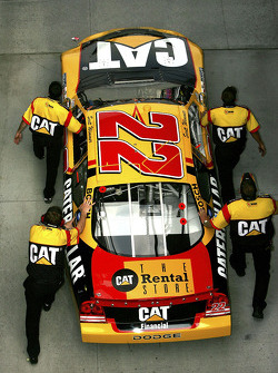 Cat Dodge crew members push the car to qualifying