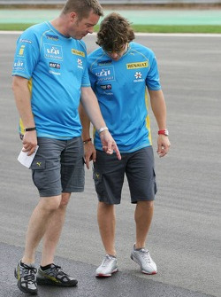 Fernando Alonso inspects the track