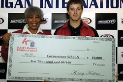 Cornerstone Schools president Ernestine Sanders accepts a ten thousand dollar donation from Kasey Kahne on behalf of the Kasey Kahne Foundation