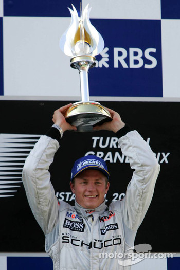 Podium: race winner Kimi Raikkonen