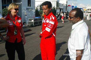 Balbir Singh, the physiotherapist of Michael Schumacher, celebrates his last Grand Prix