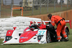 Eric Van de Poele sits in his car after the accident with the #57 Aston Martin