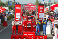 Podium: rally winners Marcus Gronholm and Timo Rautiainen, with second place Sébastien Loeb and Daniel Elena, and third place Chris Atkinson and Glenn Macneall