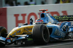 Fernando Alonso celebrates podium finish