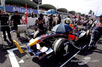 Red Bull Racing team members on the starting grid