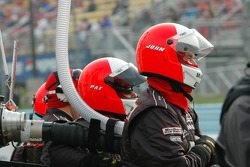 Penske crew watches the track action