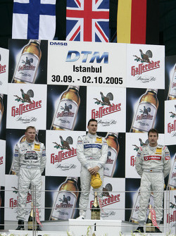 Podium: race winner Gary Paffett with Mika Hakkinen and Bernd Schneider