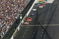Tony Stewart leads the field on the start