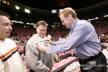 Rusty Wallace signs autographs before the start of the game between the New Jersey Nets and the Detroit Pistons at the Continental Airlines Arena in East Rutherford, New Jersey