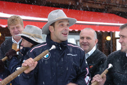 Jorg Muller blows an Alpine horn in the snow