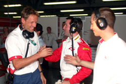 A1 Team Switzerland crew members celebrate pole position