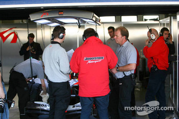 Bridgestone engineers in the MF1 Racing garage area