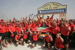 Car category podium: winners Luc Alphand and Gilles Picard celebrate with Team Repsol Mitsubishi Ralliart team members