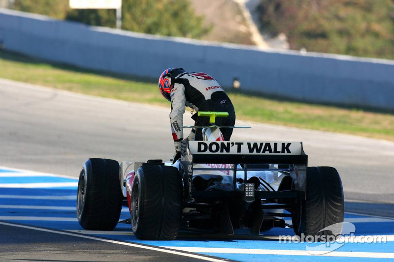 Jenson Button stopped at pit exit