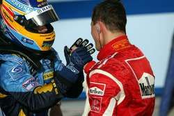 Race winner Fernando Alonso congratulated by Michael Schumacher