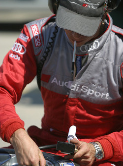 Audi team member prepares tires for the race