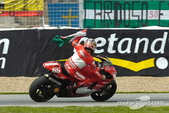Race winner Loris Capirossi celebrates