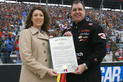 Stephanie Milo of the NASCAR Foundation and Tennessee Senator Michael Williams hold a document declaring May 19, 2006 NASCAR Day in the State Of Tennessee